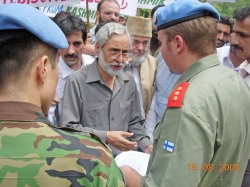 Muhammad Farooq Rehmani Chairman Jammu and Kashmir People's Freedom League presenting a memorandum to UN Officials in Azad Kashmir.